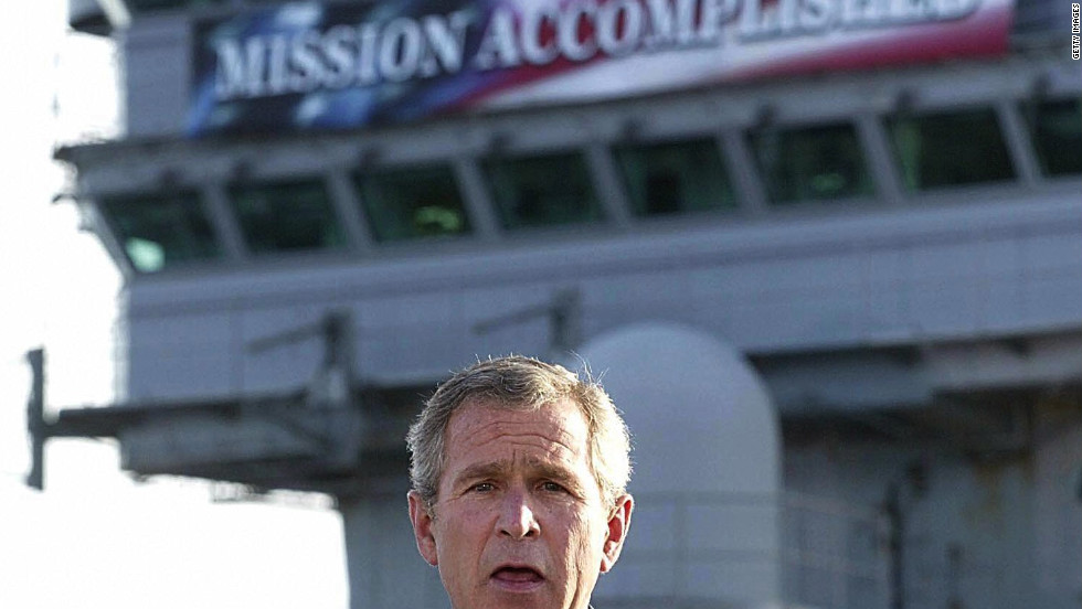 """<strong>PROMISE: """"Mission Accomplished.""""</strong> The banner aboard the USS Abraham Lincoln heralded Bush's announcement of an end to major combat operations in Iraq just months after the invasion. The fighting, however, would drag on for seven years."""