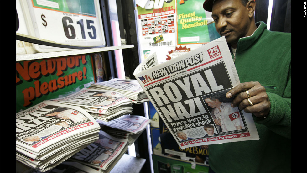 "A man reads the New York Post newspaper on January 13, 2005,  featuring the ""Royal Nazi"" headline about Prince Harry who attended a fancy dress party wearing a khaki uniform with an armband emblazoned with a swastika."