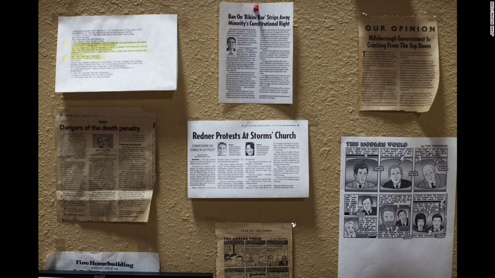 Newspaper clippings adorn the wall of Joe Redner's office. Redner opened the Mons Venus strip club in 1982 and has been fighting government opposition since that time.