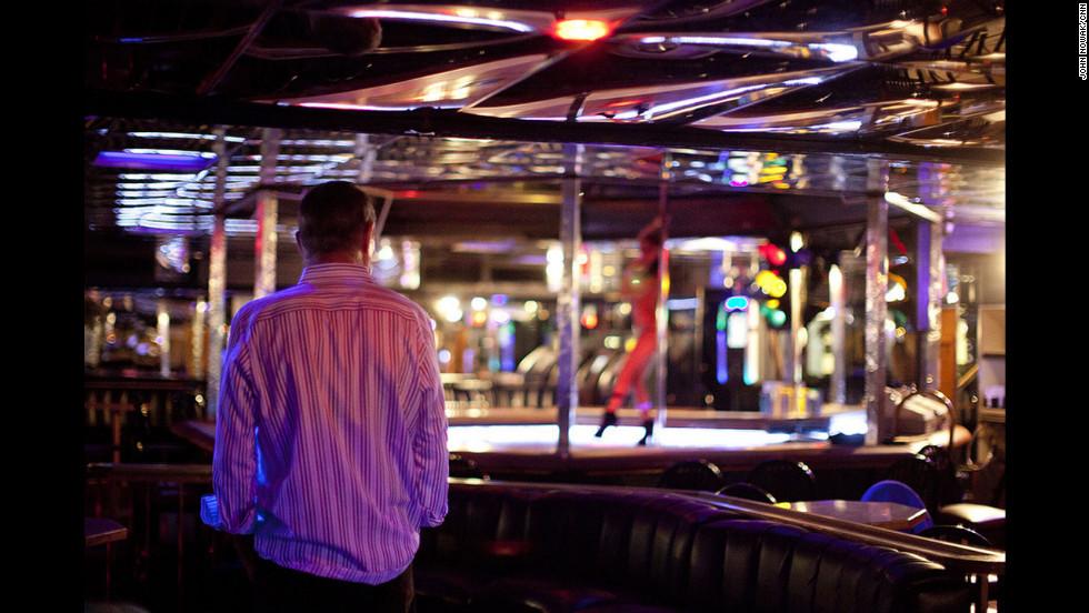 Joe Redner watches a dancer perform at his club, Mons Venus.