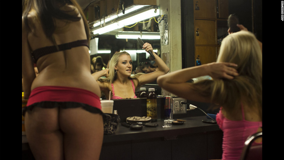 Dancers Tara, 20, left, and Tessa, 23, prepare backstage at Mons Venus. Despite its small size and lack of alcohol, the strip club is considered one of the best and most acclaimed in the United States.    <br />