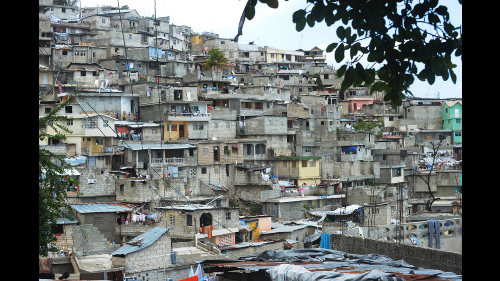 A hillslide slum in Port-au-Prince is seen on July 12. The goverment plans to tear down the homes, housing more than 3 million people, as part of a flood-control project. The structures are subject to landslides during the country's rainy seasons.