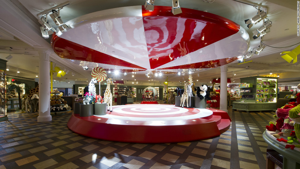 """Department store Harrods' new """"Toy Kingdom,"""" which opened in July, organizes toys and games by themes like the Big Top, where magicians and jugglers are surrounded  by fancy costumes, doll houses, rocking horses and soft toys."""