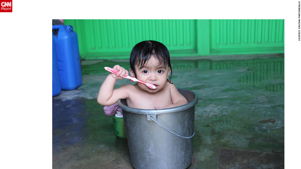 "Originally from Montreal, but now in the Philippines working on her thesis, Kristina Partsinevelos says she almost missed this priceless shot. ""I had to retrace my steps when I saw this little girl,"" she said. "" I've never seen a baby in a bucket before.""<a href=""http://ireport.cnn.com/docs/DOC-829431"" target=""_blank"">See more about the photo on Kristina's iReport</a>."