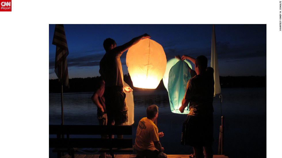 "iReporter Cindy Schultz and 26 of her family members made a summer trip to her brother's lakeside house in Minnesota, where they lit paper lanterns and watched them beautifully float over the lake. ""We talked in whispers as we watched them,"" she said. ""They puffed up into the sky like bags of microwaveable popcorn.""<a href=""http://ireport.cnn.com/docs/DOC-829842"" target=""_blank"">Read more about their illuminating summer highlight on Cindy Schultz's iReport</a>."