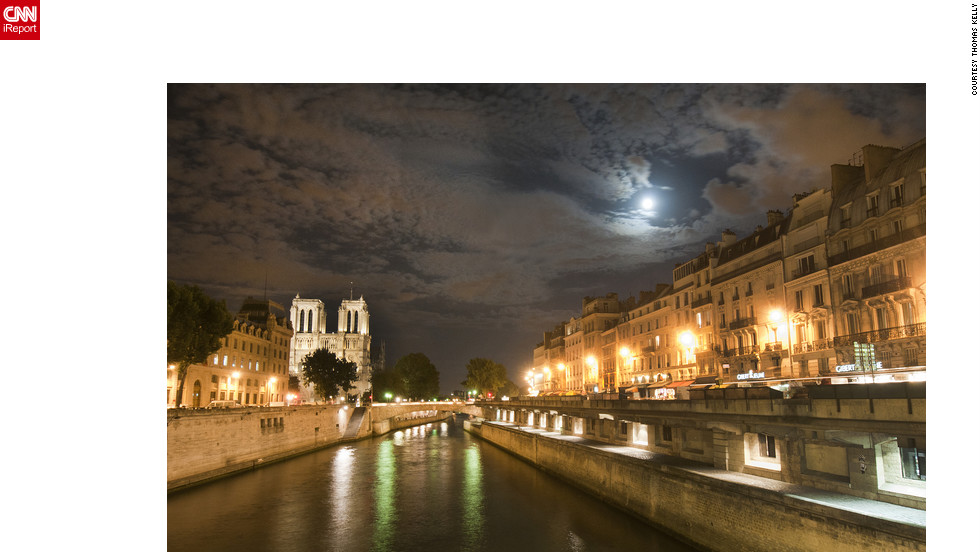 "Deciding to take a walk along the river Seine on his first night in Paris, Thomas Kelly says it was amazing to see a full moon breaking through the clouds as it illuminated the walkways. ""This scene really captures the essence of romance of one of the world's greatest cities,"" he said.<a href=""http://ireport.cnn.com/docs/DOC-830519"" target=""_blank"">Read more about Thomas Kelly's trip to the City of Lights on his iReport</a>."