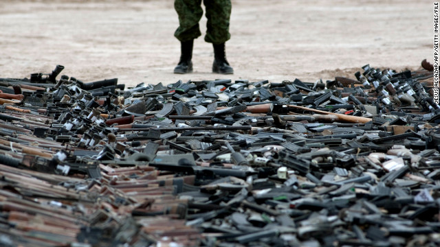 Thousands of guns lie on the ground before their destruction in Ciudad Juarez, Mexico, in February.