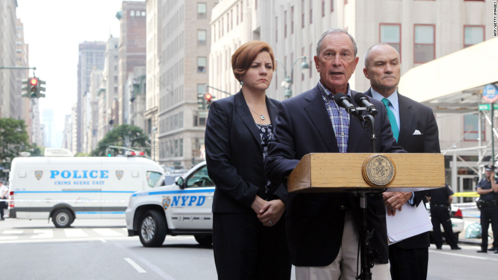 New York Mayor Michael Bloomberg, center, and Police Commissioner Ray Kelly brief reporters on the Empire State Building shooting Friday, August 24. Two people were killed, including the suspected shooter, and nine others wounded, police said. Authorities shot the gunman, whom they described as a disgruntled former employee of a business near the landmark skyscraper.