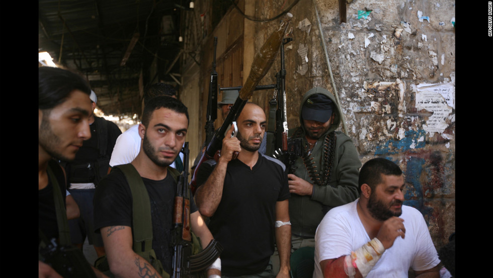 Islamic Sunni Salafist fighters wield guns in Tripoli, Lebanon, on Friday, August 24, during clashes between pro- and anti-Syrian factions. A sniper killed Sunni Sheikh Khaled al-Baradei in the city, sparking new fighting which brought the death toll to 12 over the past five days and stoked fears of a spillover of major violence from the conflict in neighboring Syria.