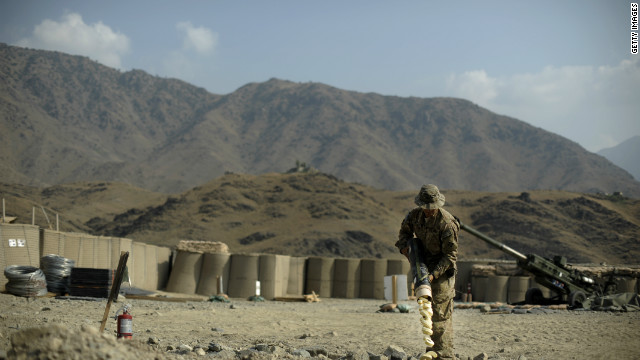 A soldier of the 4th brigade combat team 4th infantry division of the U.S. Army disposes of waste left by mortar rounds at the Forward Operating Base Joyce, in the Kunar province of Afghanistan on August 20, 2012.