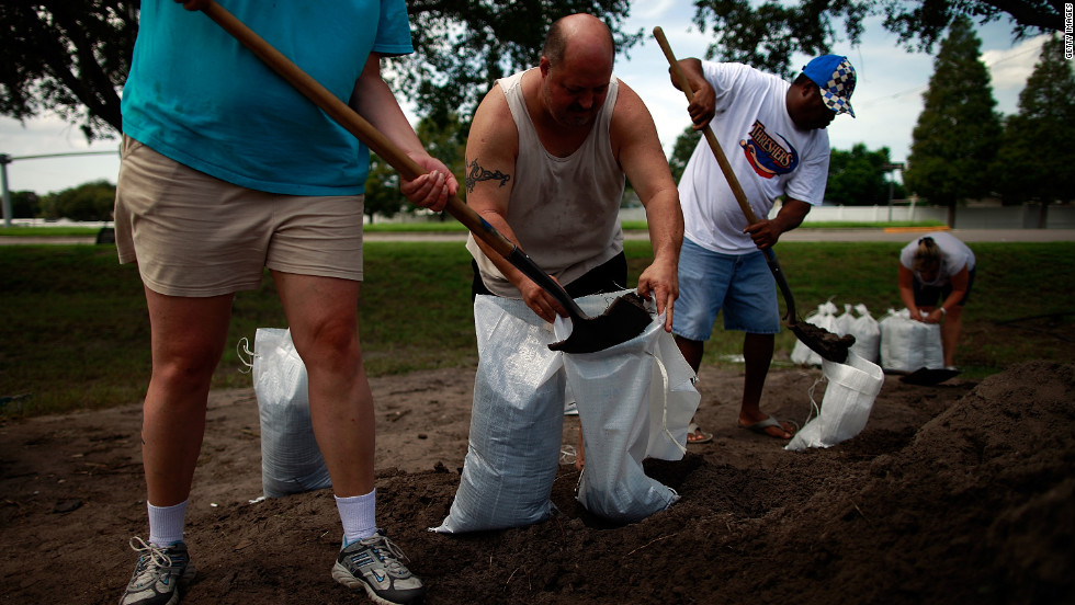 Tampa, Florida, area residents make preparations for the arrival of Tropical Storm Isaac by filling sandbags at a Hillsborough County Public Works Service Center on Saturday.