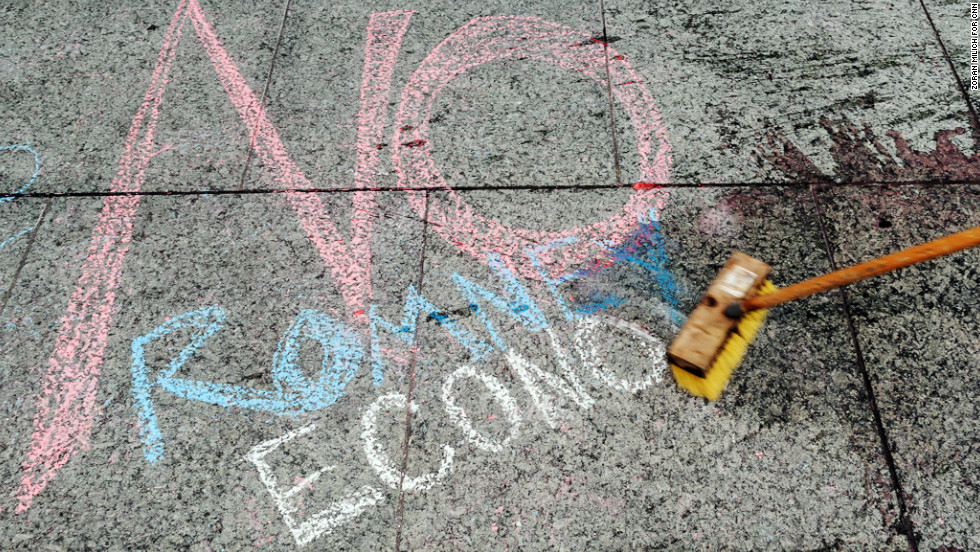 A chalk message is left by protesters a few blocks from the Tampa Bay Times Forum.