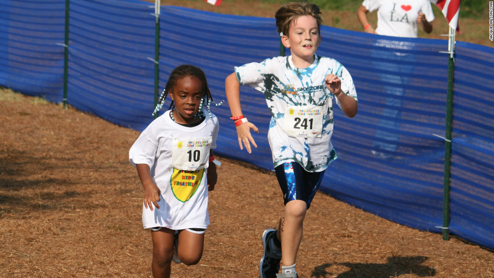 Jonah Jennings, left, puts her all into the last few yards of the triathlon.