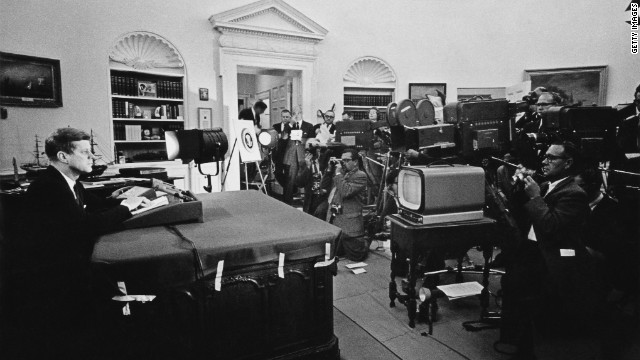 President John F. Kennedy announces on television the strategic blockade of Cuba and warns the Soviet Union about missile sanctions during the Cuban missile crisis.