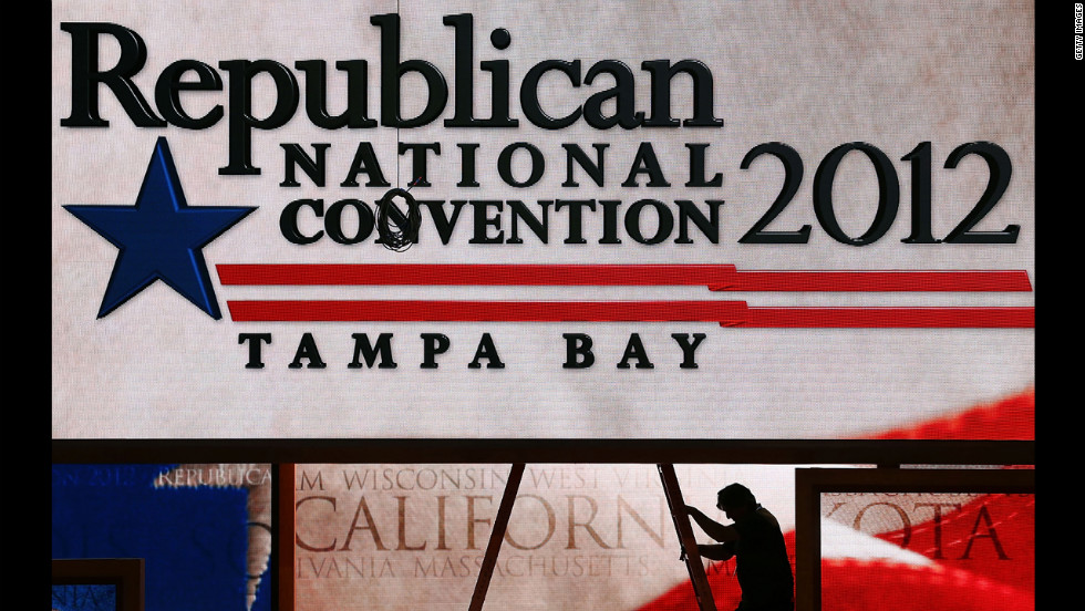 Last-minute adjustments are made to the main stage at the Tampa Bay Times Forum on the abbreviated first day of the GOP convention.