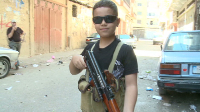 Child fighter with AK-47 on Syria border