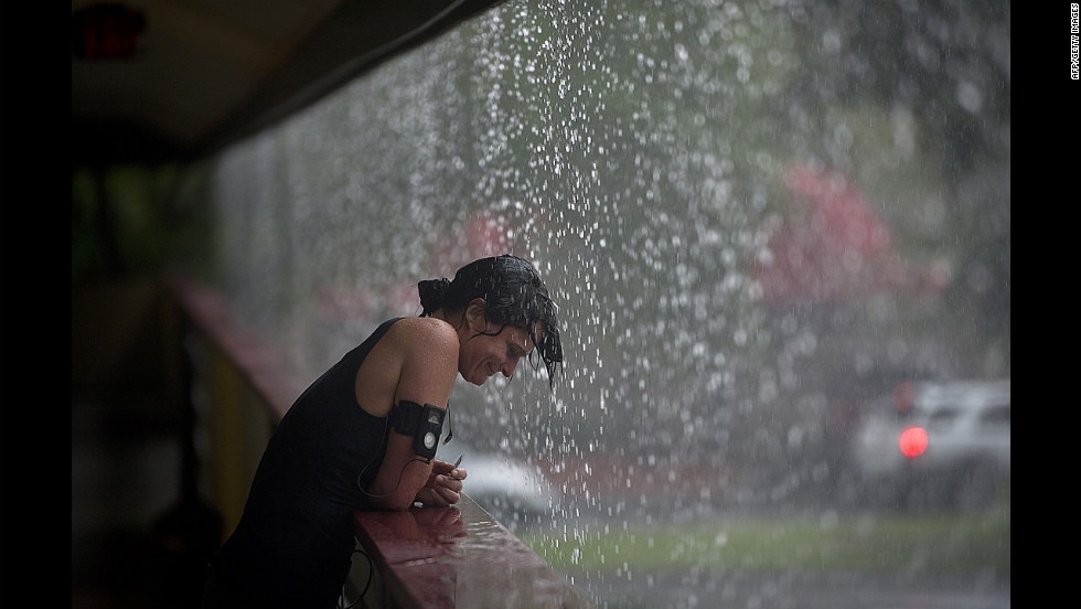 A woman enjoys the a heavy rain in the Tampa, Florida, area, on Monday. Hurricane Isaac is expected to make landfall near New Orleans.