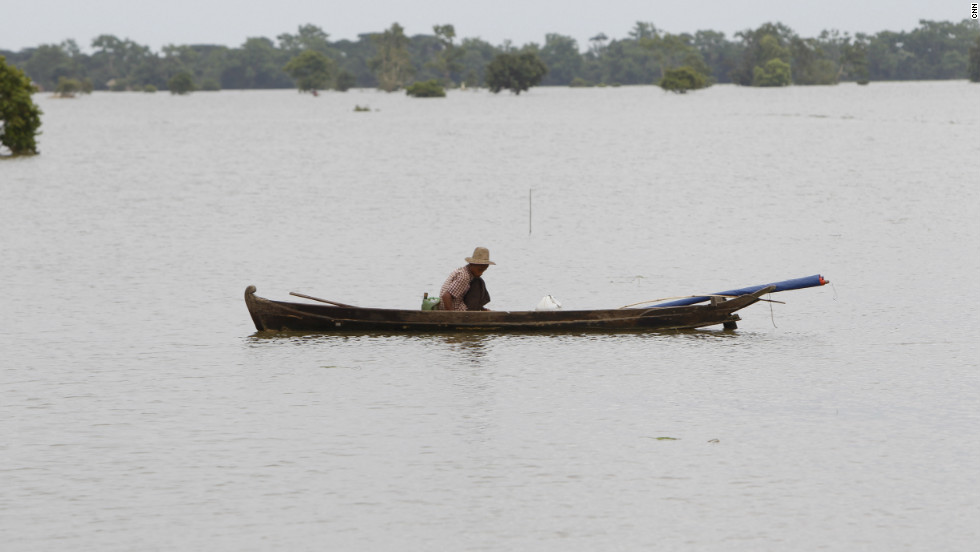 In areas badly affected by flooding, long boats have become the main form of transport