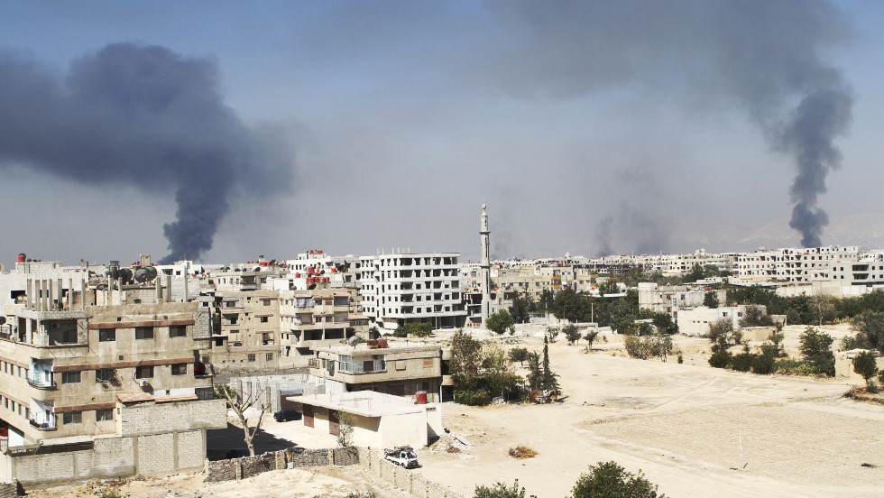 Smoke rises in the Damascus suburb of Ain Terma during clashes between Syrian rebels and pro-government forces.