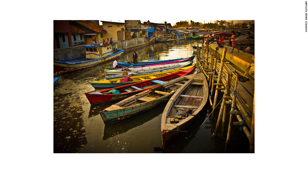 """While Pasar Ikan literally translated means """"fish market,"""" local families reside and work close by."""