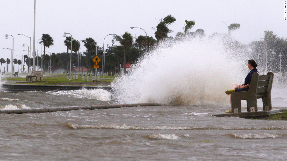 Diana Whipple of New Orleans watches waves crash on the shore of Lake Pontchartrain as Hurricane Isaac approaches Tuesday. Isaac became a Category 1 hurricane Tuesday when its maximum sustained winds reached 75 mph, the National Hurricane Center says.
