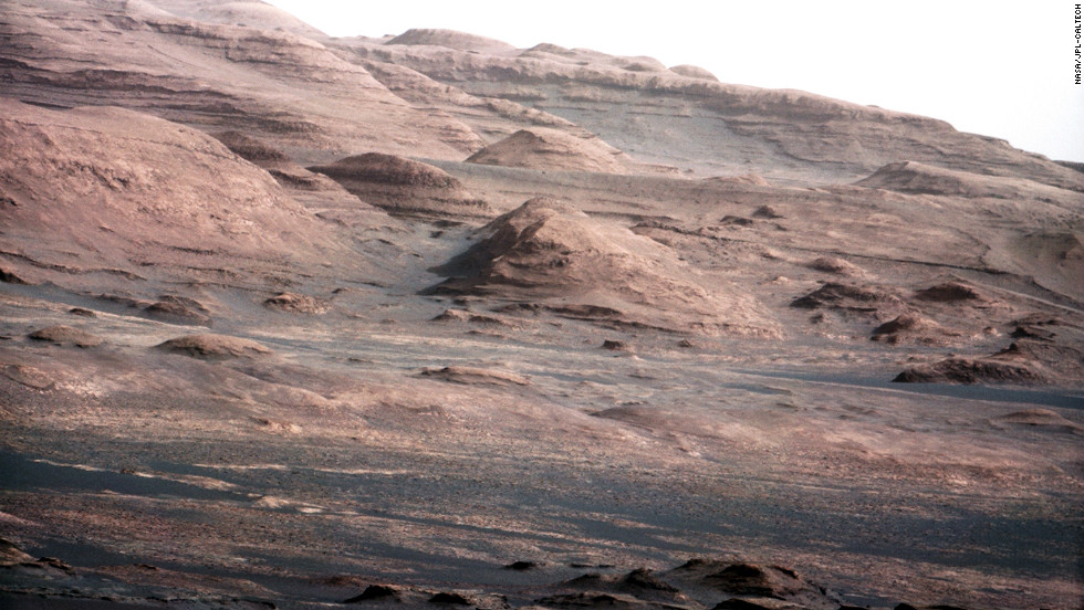 An image released August 27, 2012, was taken with Curiosity rover's 100-millimeter mast camera, NASA says. The image shows Mount Sharp on the Martian surface. NASA says the rover will go to this area.