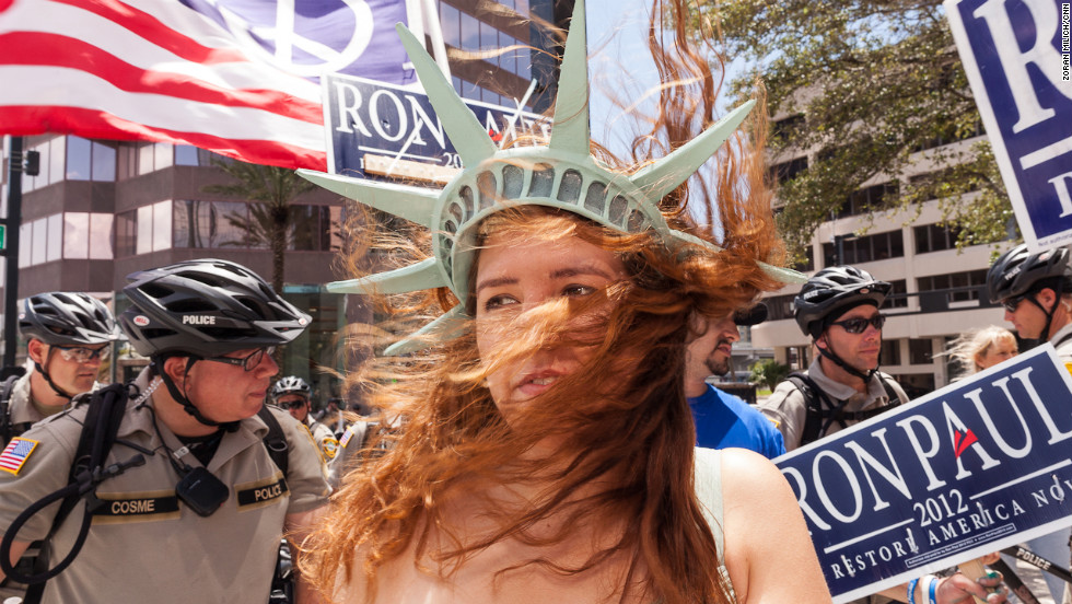 Jaclyn Tupek wears a Lady Liberty hat at a Ron Paul gathering a few blocks from the Tampa Bay Times Forum.