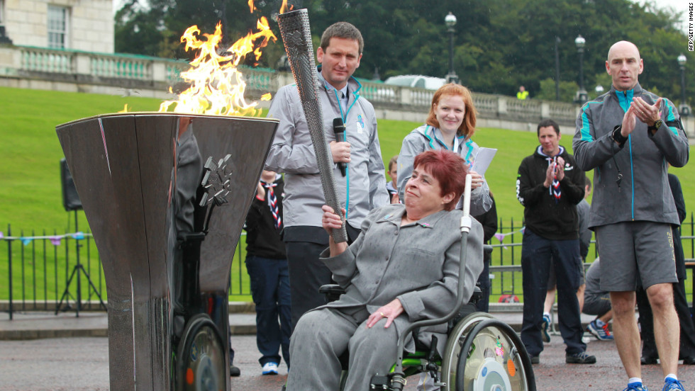 Paralympian athlete Angela Hendra prepares to light the cauldron during the London 2012 Paralympic Games lighting ceremony at Stormont Government buildings in Belfast, Northern Ireland on August 25.