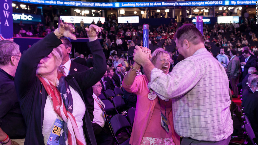 Washington state delegates Trin Wilbur and Jeff McMorris dance on the convention floor.