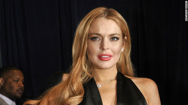 The prosecutor's report confirmed Lindsay Lohan and her assistant, Gavin Doyle were suspects, along with another man identified as Andrew Payan.