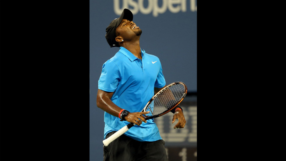 Donald Young reacts during his match against Roger Federer.