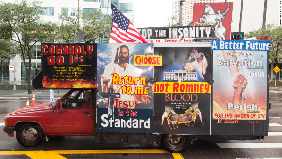One of many message-covered vehicles drives through the streets of Tampa.