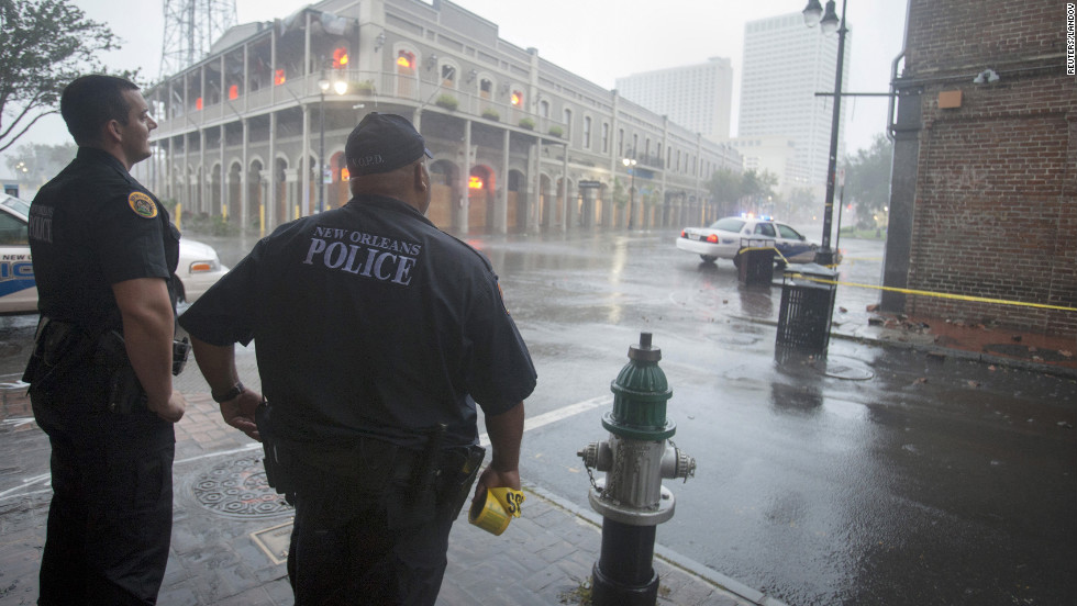 Police officers stand watch in the French Quarter.