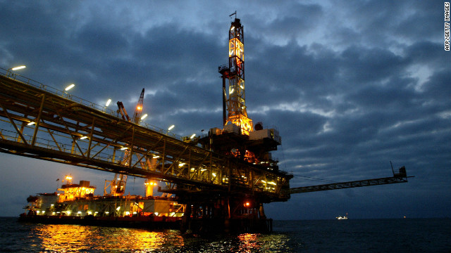 General view of an oil offshore platform owned by Total Fina Elf in the surroundings waters of the Angolan coast 15 October 2003. The 11 members of the OPEC oil cartel have agreed to slash output by a million barrels a day, the OPEC president said 11 October 2006, in a move aimed at shoring up sliding world crude prices.
