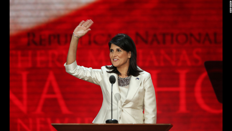 South Carolina Gov. Nikki Haley waves on stage.