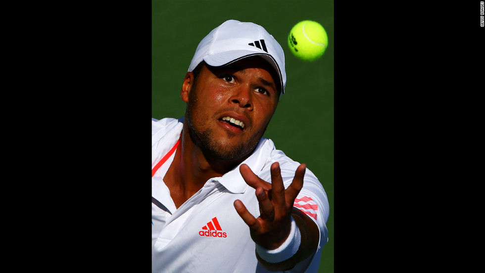France's Jo-Wilfried Tsonga serves the ball against Karol Beck of Slovakia.