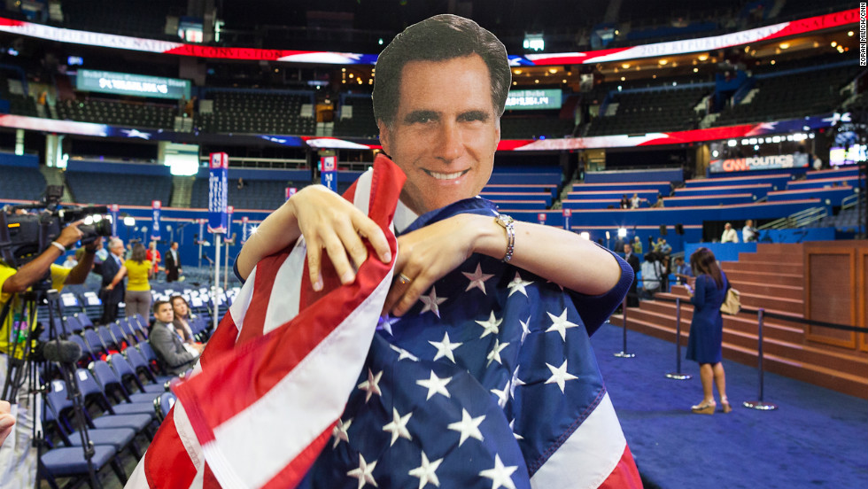 A Romney cutout is wrapped with the American flag on the floor of the convention.