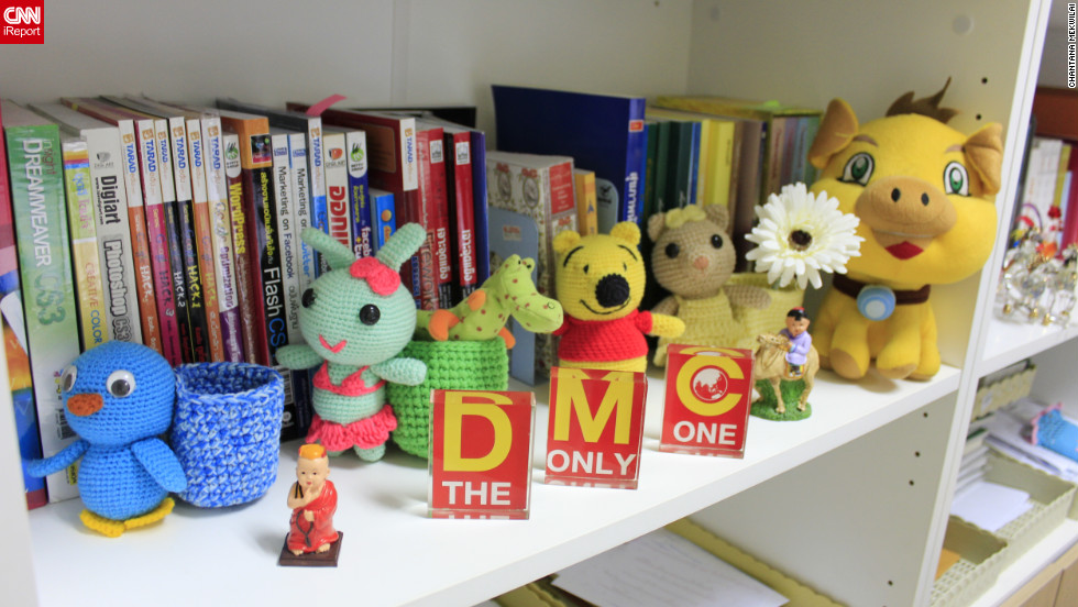 """CNN's iReporters told us that desk toys are often a chance to remind themselves of something that makes them happy. For <a href=""""http://ireport.cnn.com/docs/DOC-829935"""" target=""""_blank"""">Chantana Mekwilai</a>, that's family: the 29 year old secretary keeps dolls crocheted by her younger sister at her office in Pathumtani, Thailand. """"She took two days to learn to crochet and makes one small doll in three hours,"""" she says. """"They are so colorful and make me smile and enjoy working."""""""