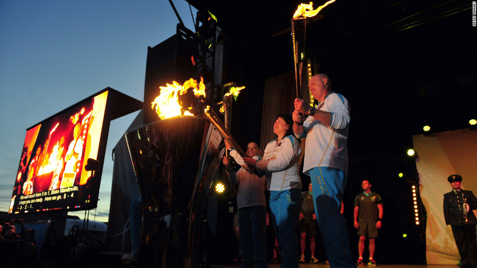 The cauldron is lit as the four Paralympic flames, which were lit on the UK's highest peaks, are united at Stoke Mandeville Hospital during the torch relay on Tuesday, August 28, in Aylesbury, England.