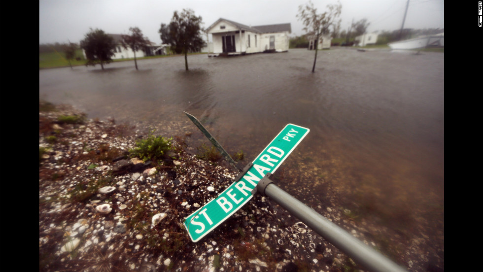 A street sign lies near floodwaters fromIsaac on Wednesday, in Braithwaite, Louisiana. Dozens were reportedly rescued in the area after levees were overtopped by floodwaters from Hurricane Isaac.