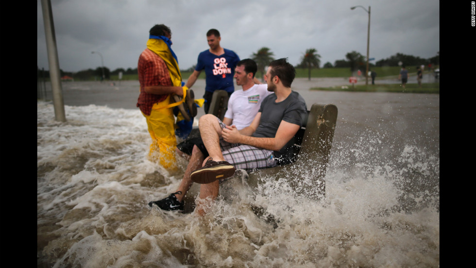 A group of men sit on a bench at the edge of Lake Pontchartrain as Hurricane Isaac approaches.