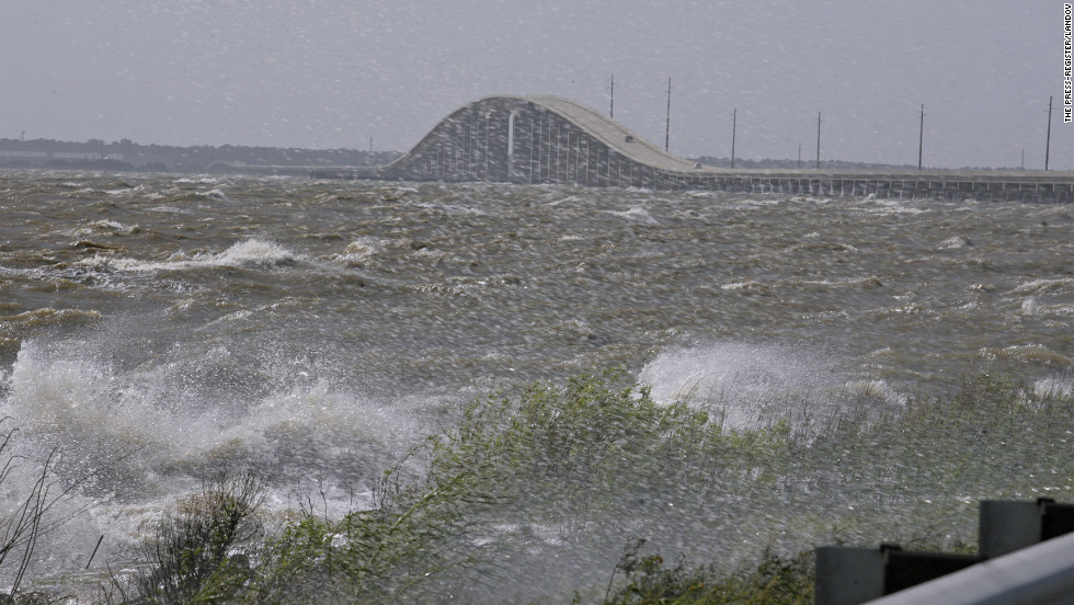 High surf splashes along Highway 193 north of the Dauphin Island Bridge in  Alabama.