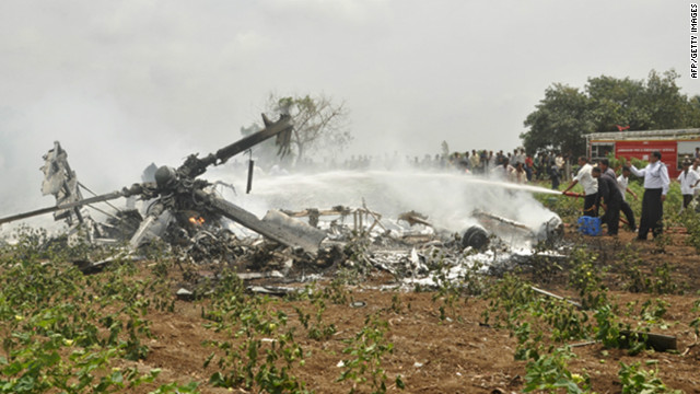 Indian rescue personnel douse the wreckage of one of two crashed Indian Air Force Mi-17 helicopters on August 30, 2012.