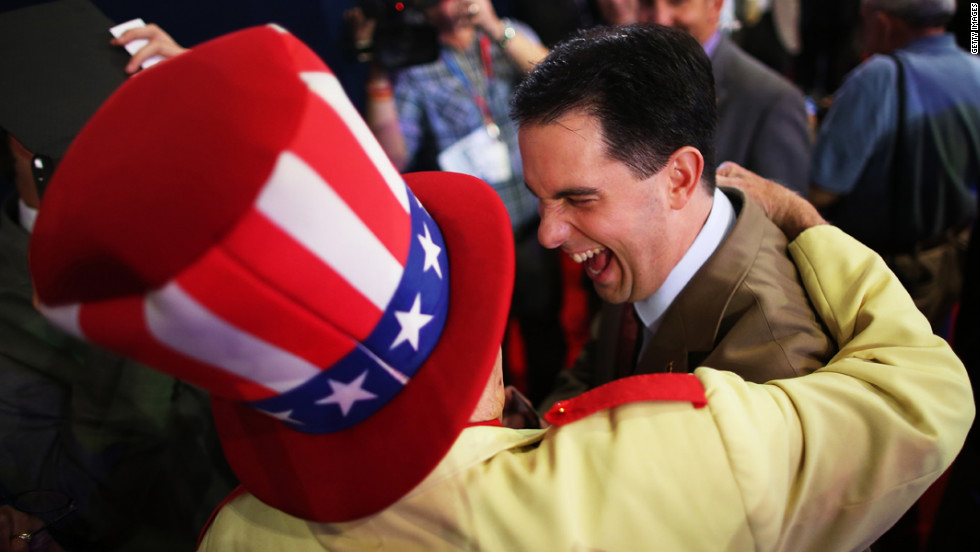 Col.Oscar Poole of Georgia puts his arm around Wisconsin Gov. Scott Walker.
