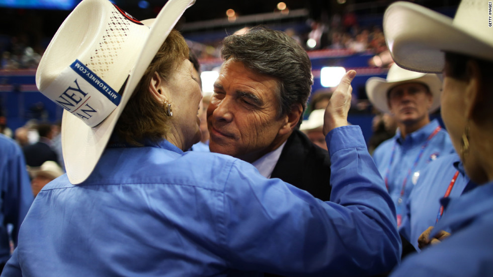 Rosemary Edwards of Austin, Texas, kisses the face of Texas Gov. Rick Perry.