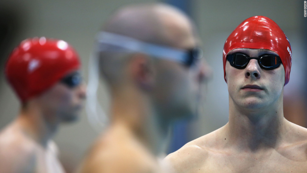 Jack Bridge, right, of Great Britain prepares to compete in the men's 200-meter individual medley - SM10 heat 2.