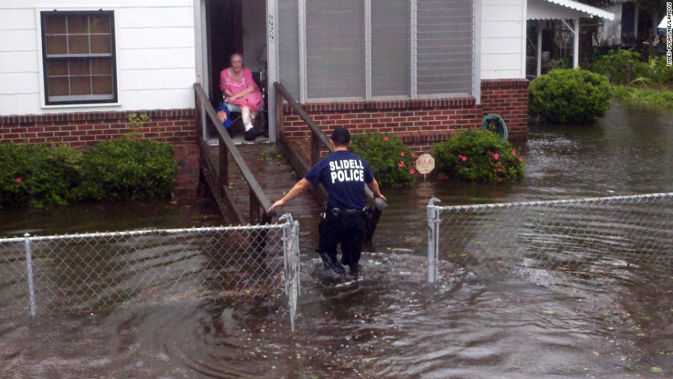 An elderly resident is rescued from her home in Slidell.