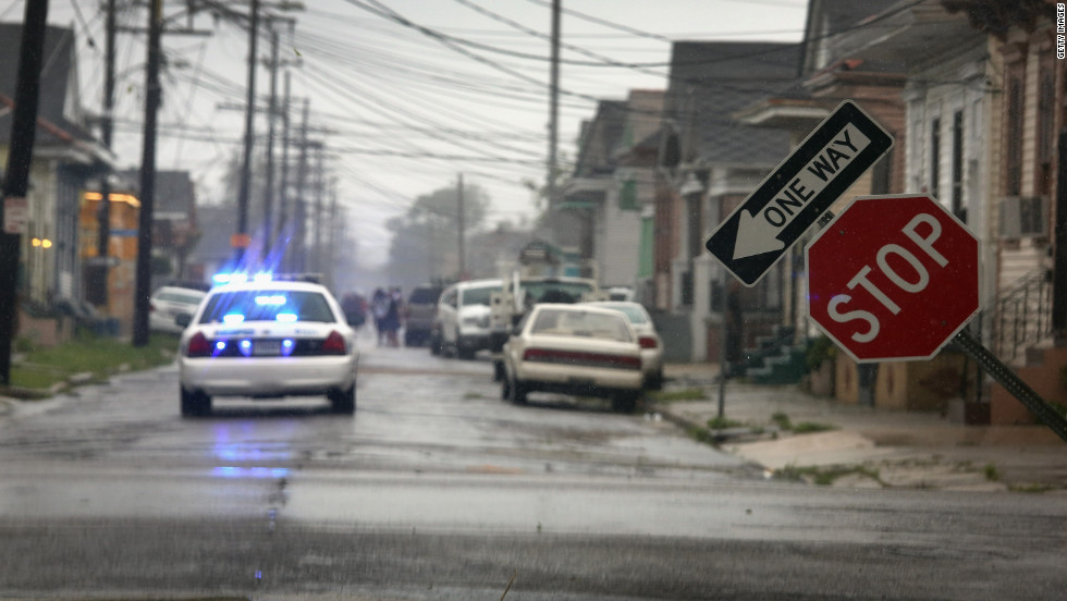 A stop sign stands askew in New Orleans after being blown by Isaac.