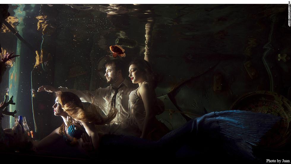 Mermaids swim in a huge aquarium above the bar at Sacramento's Dive Bar.
