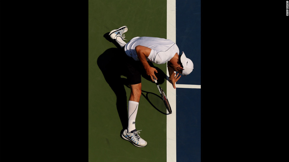 Philipp Petzschner of Germany slides during his men's singles second-round match against Nicolas Almagro of Spain.
